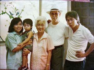 """Lorna cuddling baby David, Grandma """"Enyang"""", Grandpa """"Asyong"""", Glenn"""