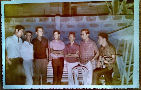 ". . Original CAFAsingers singing, perhaps, ""Man from Egypt"" . Glenn A. Bautista: Sorry, I forgot to include Onie, hehe . . tatlo pala! and where was Sammy? Dinky von Einsiedel: Is that Sammy between me and Ely? This is a nice remembrance of times past, Glenn. How can I enlarge it? Thanks for sharing! Glenn A. Bautista: Yes, Dinky, that's Sammy . . it was really small and unrecognizable. Note the dark areas behind our heads indicating a strong flash was used. There was no demarcation at all, I tried separating the head from the shadow. Try this one I just made a bit bigger. It was only 28kb! Glenn A. Bautista: RomyB hardly changed . . . Eduard Percival Labadia: Hi, Glenn Bro, musta na? bakit ang liit namang file yan... kanino nagmula ba yan? Si Romy na pala yan? Makikilala ko pa rin siya anytime na magkakabanggan kami... hahaha, bass ang boses nyan, di ba? Glenn A. Bautista: Hi Eduard, happy to hear from you, CFA & Banggaan bro. Oo nga, but I don't know where my son, David got this photo. David likes looking into family pictures and history. I am fortunate to have such a son like him. Are you back in Pinas, and for good? Weather in NJ has not been that good the past months. - EdLab pala, do you have any photo of you and Ping with the guitar singing at the UPCFA amphitheater, or any related photo? I'd like to include this in my CAFA blog if you have any: https://glenlorndav.wordpress.com/.../ Eduard Percival Labadia: Glenn'bro, andito ako ngayon sa NJ since Aug. 22nd visiting our daugh here in Jersey City. I touched base with Dinky since yesterday.. I got just one picture with Ping, the late Vads Revadillo and the rest of the Extremes.. anduon din yata si Adi Baenz-Santos.. hahalungkatin ko pa... okay lang weather dito sa NJ ngayon... actually I've just started taking off shadows on the wall in this CAFA pix you sent Dinky, before the end of the day, tapos yan... sofasogo with the two guys at extreme left Glenn A. Bautista: hehe, d ka rin nakatiis, kamukha kasi lahat ni ""Prince o Frankenstein"" pag may shadow sa ulo, binawasan ko na yan, dati black lahat yan at beyond recognition ang boong pic . . Eduard Percival Labadia: they should come out decent enough for positive recognition after my ""lay hand"" rituals, hahaha... I'll try to beat a CCTV blurry imaging should try figuring out how to make Romy's patented crew-cut distinct and on the groove with the time. Eduard Percival Labadia: Teka, teka, I believe I might have confused Adi's crew cut with Romy's equally straight hair but with Pol Salcedo's greased lighting with ""hati"" sa kaliwa, right?"