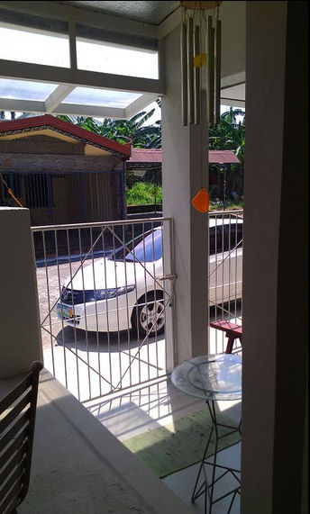 View from inside garage - David's white Honda parked outside.