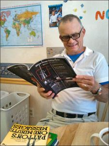 "My PGA Pro Golf Instructor reading my book, ""Mirror-Image Swing Plane"". / Melbourne, Florida."